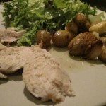 dinner plate of chicken potatoes and salad greens