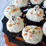 Chocolate Cupcakes with vanilla frosting, pumpkin sprinkles, and gummy ghosts