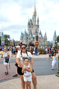 Mother and daughter standing in front of Castle in Magic Kingdom at Halloween Party