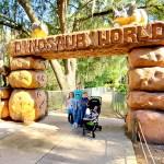 kids standing under entrance to dinosaur world