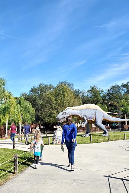 Entry area of dinosaur world showcasing large dinosaur statues