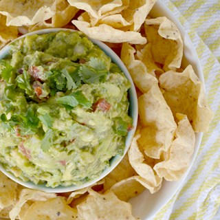 overhead view of finished guacamole surrounded by tortilla chips