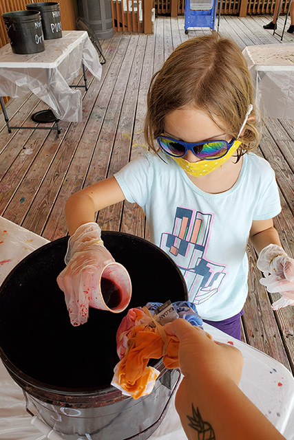 little girl doing a tie dye shirt