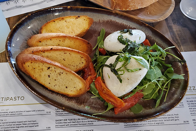 Plate of burrata with toasted crostini