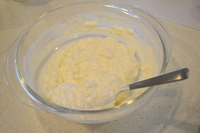 mixture of sour cream, mayonnaise, and cream cheese in a glass bowl