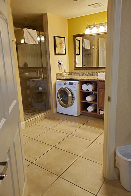 Shower and combo washer dryer unit in bathroom in One Bedroom Villa at Westgate hotel