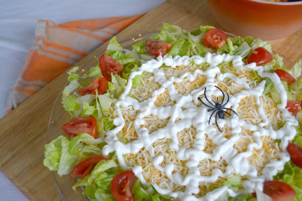 close up of 7 layer Halloween Spider Web Taco Dip