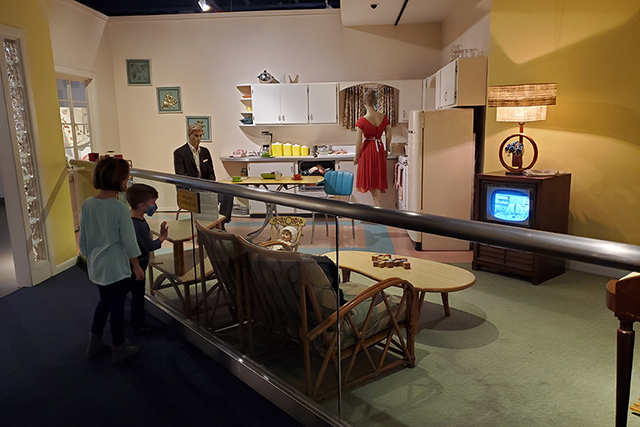 kids looking at exhibit featuring 50's style house at MOSH in Jacksonville