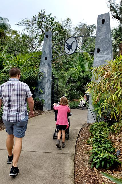 family walking into Dinosaur Invasion at Leu Gardens