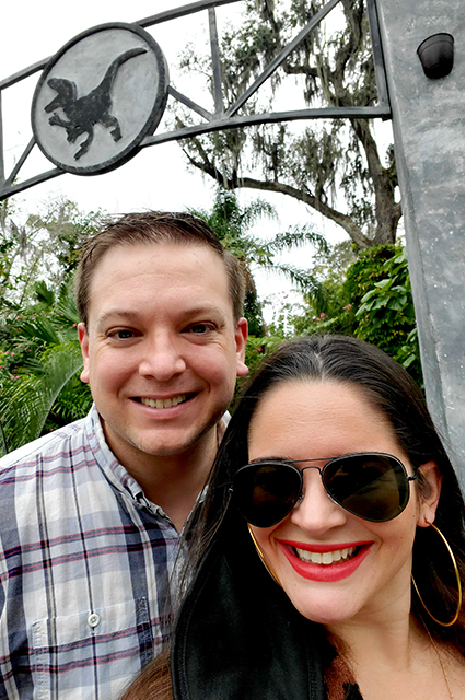 selfie of man and woman together while woman wears sunglasses and red lipstick