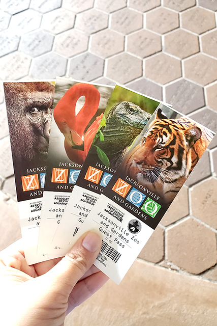 hand holding 4 tickets to the jacksonville zoo