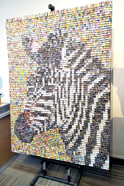 artwork that is a collage of folded paper pieces to look like a zebra