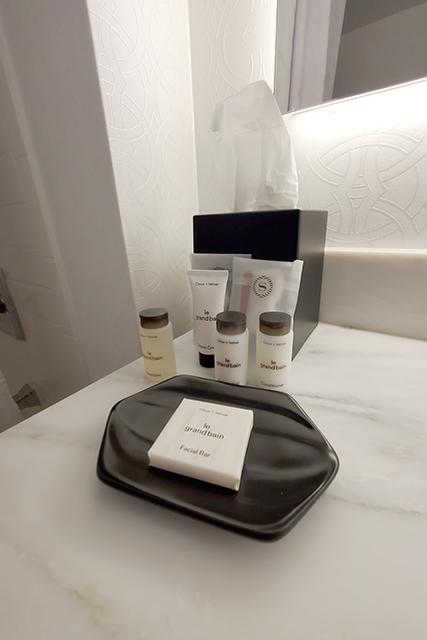 arrangement of toiletries inside a sheraton hotel bathroom
