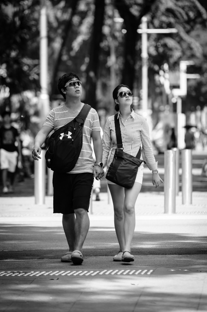 Street photography - Matching couple looking upwards