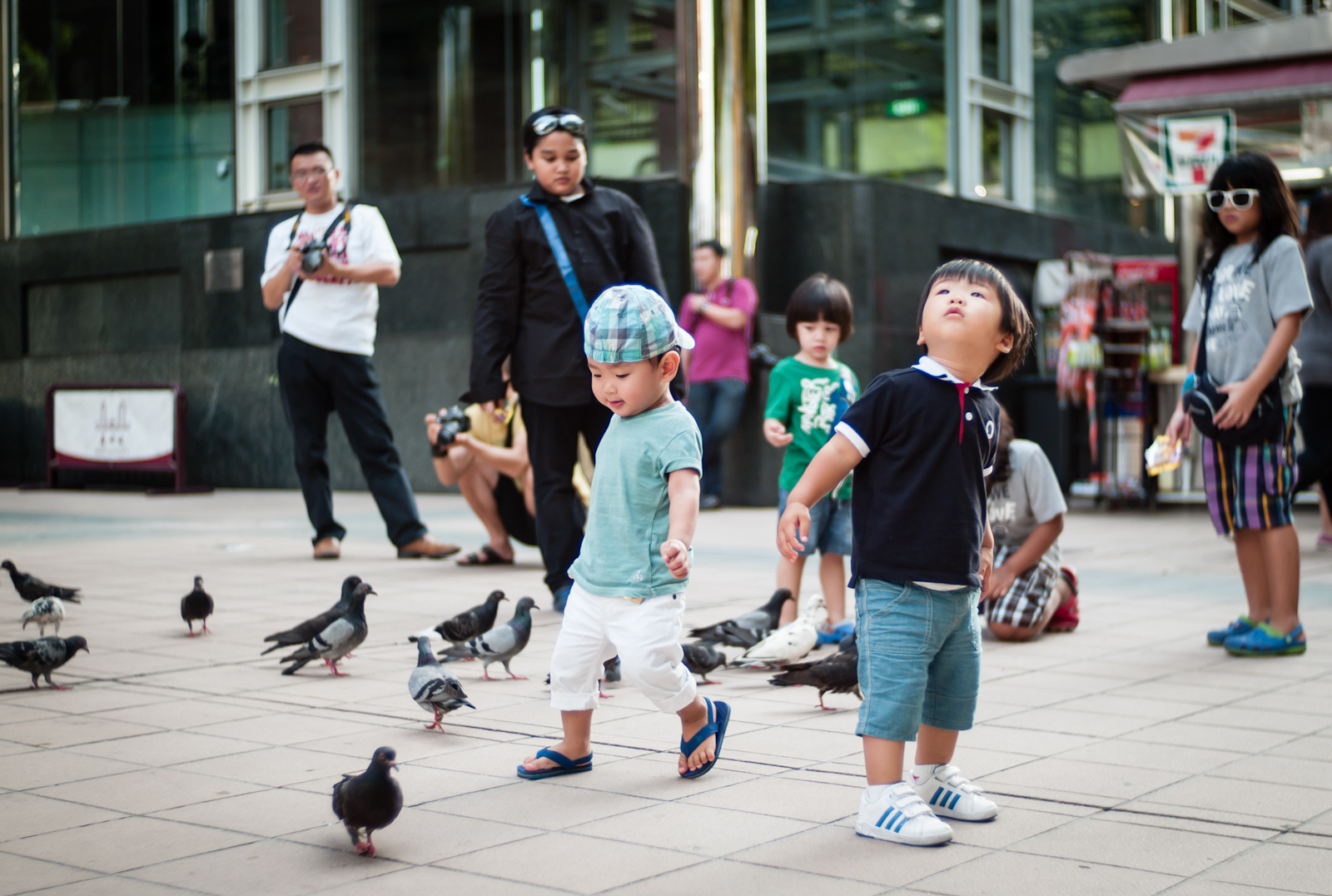Children chasing pigeons in Orchard Road