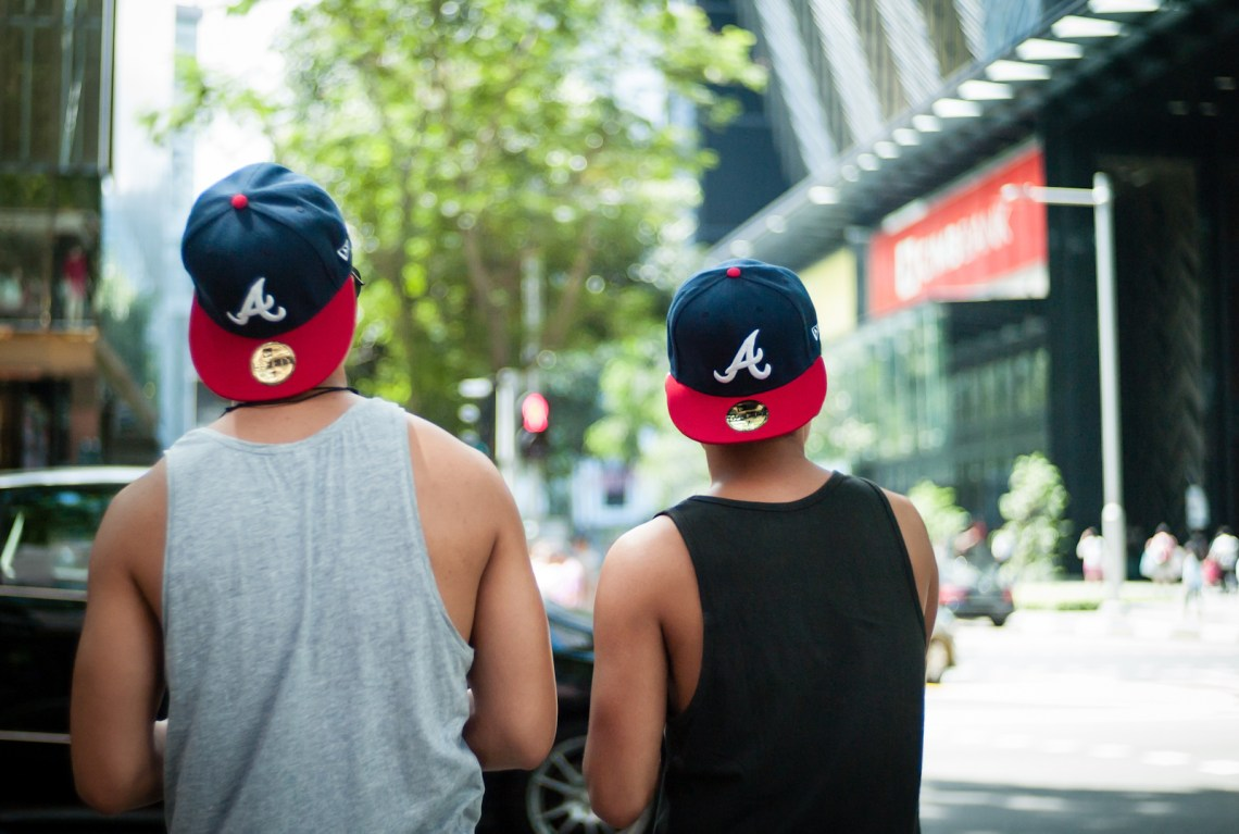 Two men wearing caps