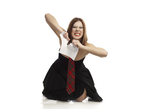 angry woman tearing paper
