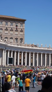 A scene when the pope speaks to the people on a Sunday afternoon. The window at the top floor with a red fabric is where the Pope Stands