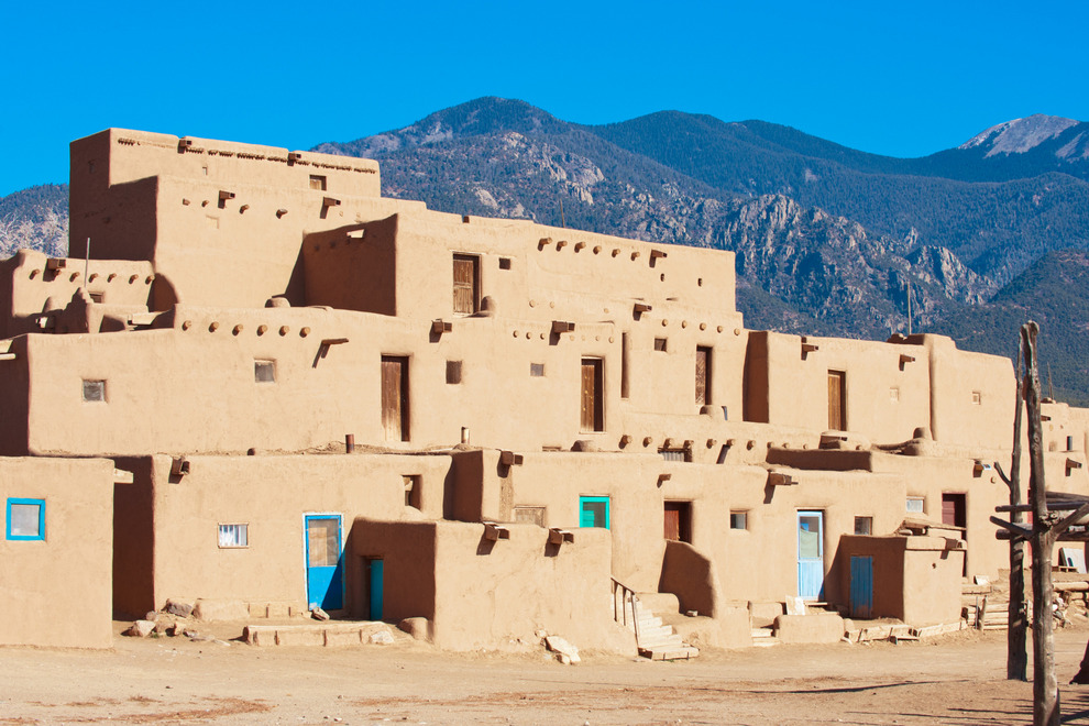 Taos Pueblo is a real-life adobe settlement that offers a look into the culture of the Pueblo Indians of New Mexico and Arizona. This interesting pueblo, which has existed for nearly 1000 years, holds the honor as the only living Native American community designated as both a World Heritage Site by UNESCO and a National Historic Landmark. Photo courtesy of Natalia Bratslavsky/iStock