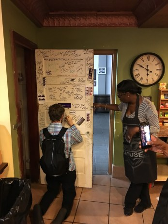 Our CEO Matt autographing the visitors' door at Motor City Java House