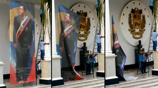 Pendones con la imagen de Chavez son retirados.