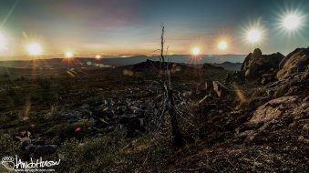 The sun just sets on the longest day of the year, summer solstice, from the top of Finger Mountain, Dalton Highway, Alaska.