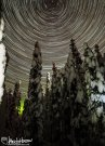 A long star trails on captures a spike of a aurora activity and the world as it spins around the north star. Fairbanks, Alaska.