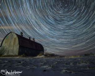 A winter scene is punctuated by a clear, moonless night and lots of stars!