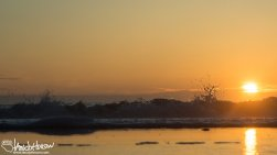 A beautiful sunset and ocean scene along the coast of California.