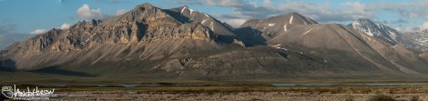 The northern edge of the Brooks Range up Atigun Gorge is lite by the solstice sun.