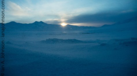 Chandlar shelf sunrise. Lots of blowing snow gives this picture a 'hazy' feel.