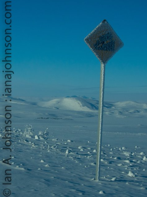 A cold 'steep slope' sign with Toolik Field Station in the Background