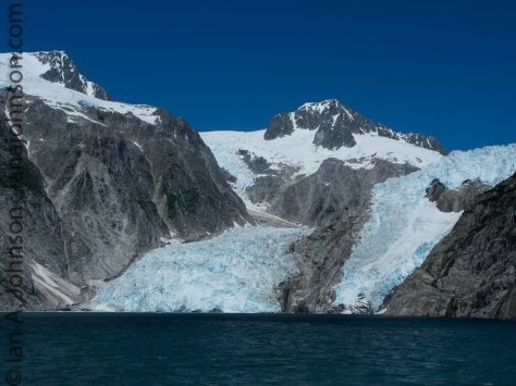 The northwestern glacier reaches about 1/2 mile from side to side. It's split into two 'lobes' by a rock face.