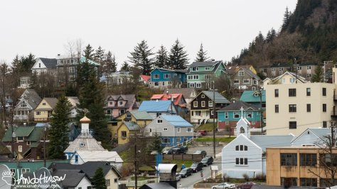 The steep hillsides of Juneau, and the surrounding mountains forces buildings to be built on high-grade slopes. Here's a colorful array of buildings in upper, down-town Juneau as seen from the boardwalks.