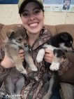 Kassie poses with a couple pups!