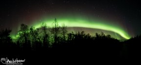 A panorama capturing this vibrant band of aurora stretching across the southern sky.