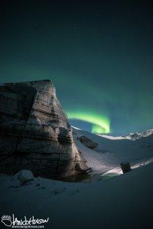 The aurora borealis flares up over Castner Glacier, Delta Junction, Alaska