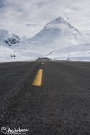 An unknown peak rises up over the road system in Haines, Pass