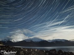 Stars, mountains, clouds, and full moon over Haines, Alaska.