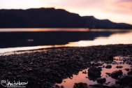 A vibrant sunset reflects off the inter-tidal zone in Hoonah, Alaska