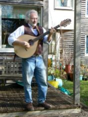 Doc Rossi plays his new instrument on the front deck.