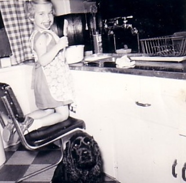 Ellen making frosting Oct 1955 - Copy