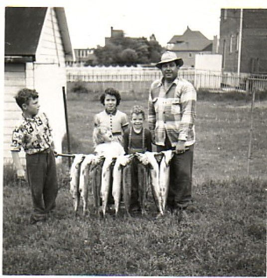 Carl Wagner (far right) with his children proudly show off their catch of fish
