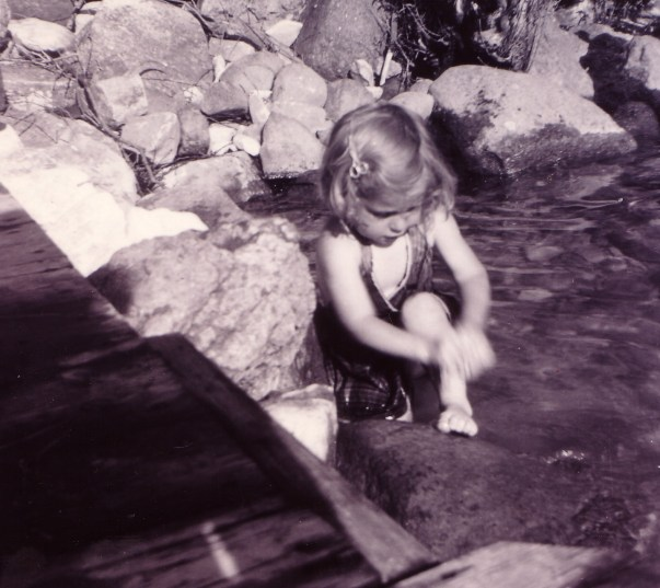 Ellen (Wagner) Hadden, aged 4, playing in the water at her parental family's cottage