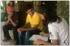 Maha interviewing a young forest guard at the ticket counter.