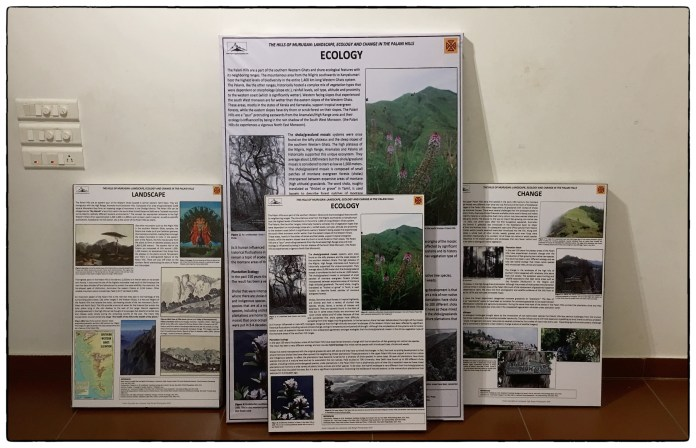 Information posters being prepared to be hung in the interior gallery space.