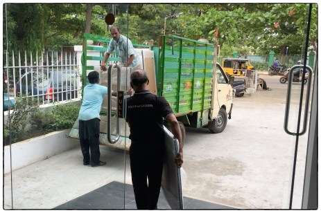Loading the frames at Focus Gallery in downtown Chennai.