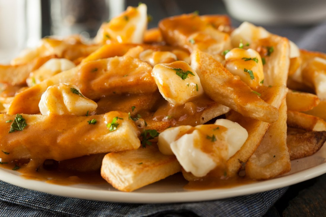 A photo of poutine, a delicious Canadian dish of French fries topped with cheese curds and gravy.