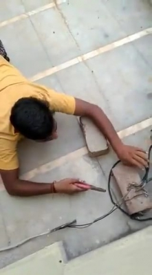 Power thief's snake crawl to cut wires caught on video