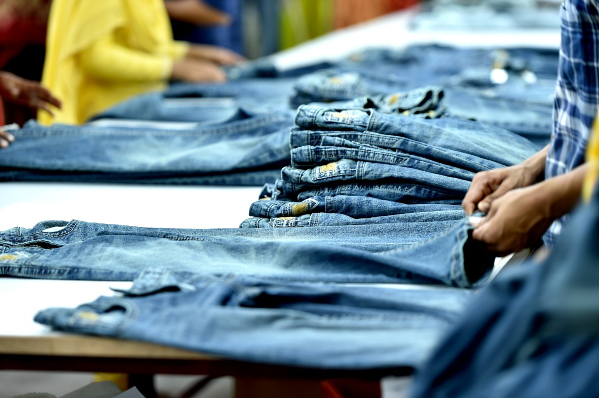 Dhaka, Aug. 12, 2020 (Xinhua) -- A worker measures the quality of a product at a garment factory in Dhaka, Bangladesh, on Aug. 12, 2020. Bangladesh's July export income was over 44 percent higher than that in June, meaning the country's export sector is limping back to normalcy after suffering serious blows owing to COVID-19 impacts. Of the total earnings, the Export Promotion Bureau (EPB) data showed the country's income from ready-made garment items, including knitwear and woven, stood at 3.24